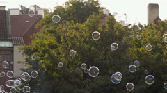 Soap bubbles floating in the happy air in the center of the Prague Old Town Squa Stock Footage