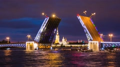 Illuminated Night Raising of the Palace Bridge in Saint Petersburg, Russia Stock Footage
