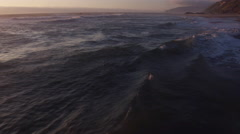 Aerial view of beach waves at sunset, Lincoln City, Oregon Stock Footage