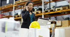 4k, Angry businesswoman having a heated argument over a phone in a warehouse Stock Footage