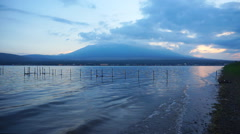 Mount Fuji on dusk with lake Yamanaka Stock Footage