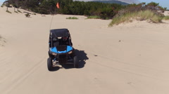 Aerial view of ATV driving on sand dunes, Oregon Stock Footage