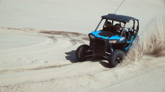 Super slow motion shot of ATV driving on sand dunes, Oregon, shot with Phantom Stock Footage