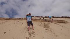 Boys sandboarding on dunes, Oregon Stock Footage