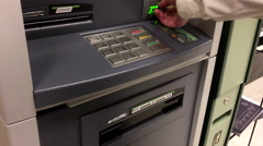 Woman withdraw cash from ATM machine inside TD Bank Stock Footage