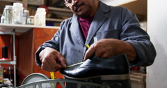 Shoemaker measuring a shoe with measure tape Stock Footage