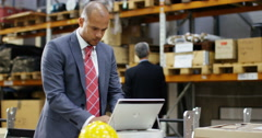 4k, Tired businessman with a concerned look working at a large warehouse. Stock Footage
