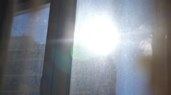 Solar flare through the curtain on a dirty window Stock Footage