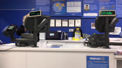 Pan shot of people returing items at customer service counter Stock Footage