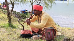 Portrait snake charmer adult man in turban and cobra . Pokhara, Nepal Stock Footage