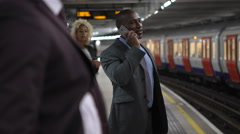 4K Businessman talking on phone as he waits for train on the London Underground. Stock Footage
