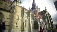 Tourists walking near Cathedral of Notre Dame of Lausanne in Switzerland, travel Stock Footage