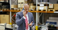 4k, Angry businessman having a heated argument over a phone in a large warehouse Stock Footage
