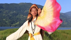 Shemale Sirena Sabiha dancing with a fan at dawn in Pokhara, Nepal Stock Footage