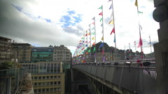 Lausanne bridge with colored flags under cloudy sky, holidays in Switzerland Stock Footage