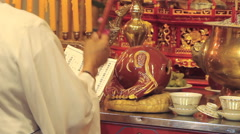 Buddhist monk chanting with drum Stock Footage
