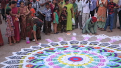 Artists create pattern of the rangoli on the pavement Stock Footage
