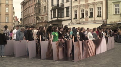A volunteers team flash-mob in the Old Town Square in Prague. A group divided pa Stock Footage