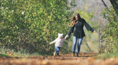 Mother walk with baby outdoor at park Stock Footage