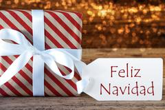 Atmospheric Gift With Label, Feliz Navidad Means Merry Christmas Stock Photos