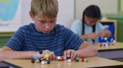 Children in school classroom building science models Stock Footage