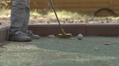 SLOW MOTION: Little boy tries to beat golf ball Stock Footage