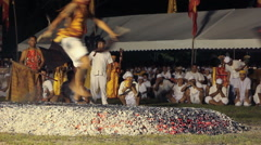 Devotees of the Chinese Shrine Jui Tui runs across hot coals Stock Footage