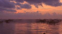 Thai style fishing trap in Pak Pra Village at sunrise. Stock Footage