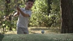 SLOW MOTION: Little golfer beats a golf ball Stock Footage