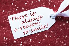 One Label On Red Background, Snowflakes, Quote Always Reason Smile Stock Photos