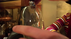 Close-up of male hands pouring light beer into glass at restaurant, alcohol Stock Footage