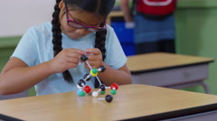 Young girl building a molecule model Stock Footage