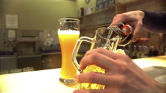 Male hands pouring bottled alcohol into glass at pub, beer brewing industry Stock Footage