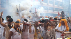 Firecrackers explode over devotees of Chinese Bang Neow shrine Stock Footage