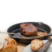 Pork chop seared on iron skillet Stock Photos