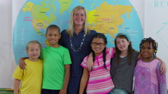 Portrait of teacher and students in school classroom Stock Footage