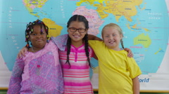 Portrait of three multi-cultural girls in school classroom Stock Footage