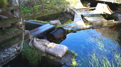Water wheel and weir in Japanese village. Japan Stock Footage