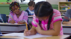 Students writing in school classroom Stock Footage