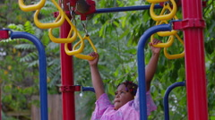 Girl playing on school playground Stock Footage