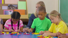 Teacher and students in school classroom work with shapes Stock Footage