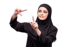 Muslim woman in black dress isolated on white Kuvituskuvat
