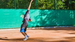 Coaching or teaching play tennis on a court outdoor. Training of professional Stock Footage