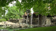 Serene park with man made waterfall, forest setting Stock Footage
