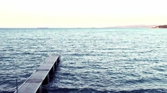 Man strolling along the pier and the waves lapping on the pier in the Adriatic. Stock Footage