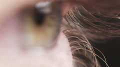 Super macro shot of female teen green eye in slow motion Stock Footage