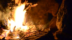 Fire burns in the campaign. pot of tea by the fire. Stock Footage