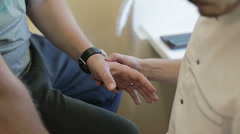 The doctor examines and palpates the patient's damaged hand. The scar on thumb. Stock Footage