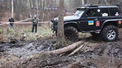 KIEV, UKRAINE - November 28, 2015: SUV Nissan Patrol rides through the woods Stock Footage