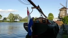 Dutch flag on the back of a boat on a canal Stock Footage